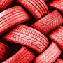 A close-up of a tangle of red tires creating an interesting pattern