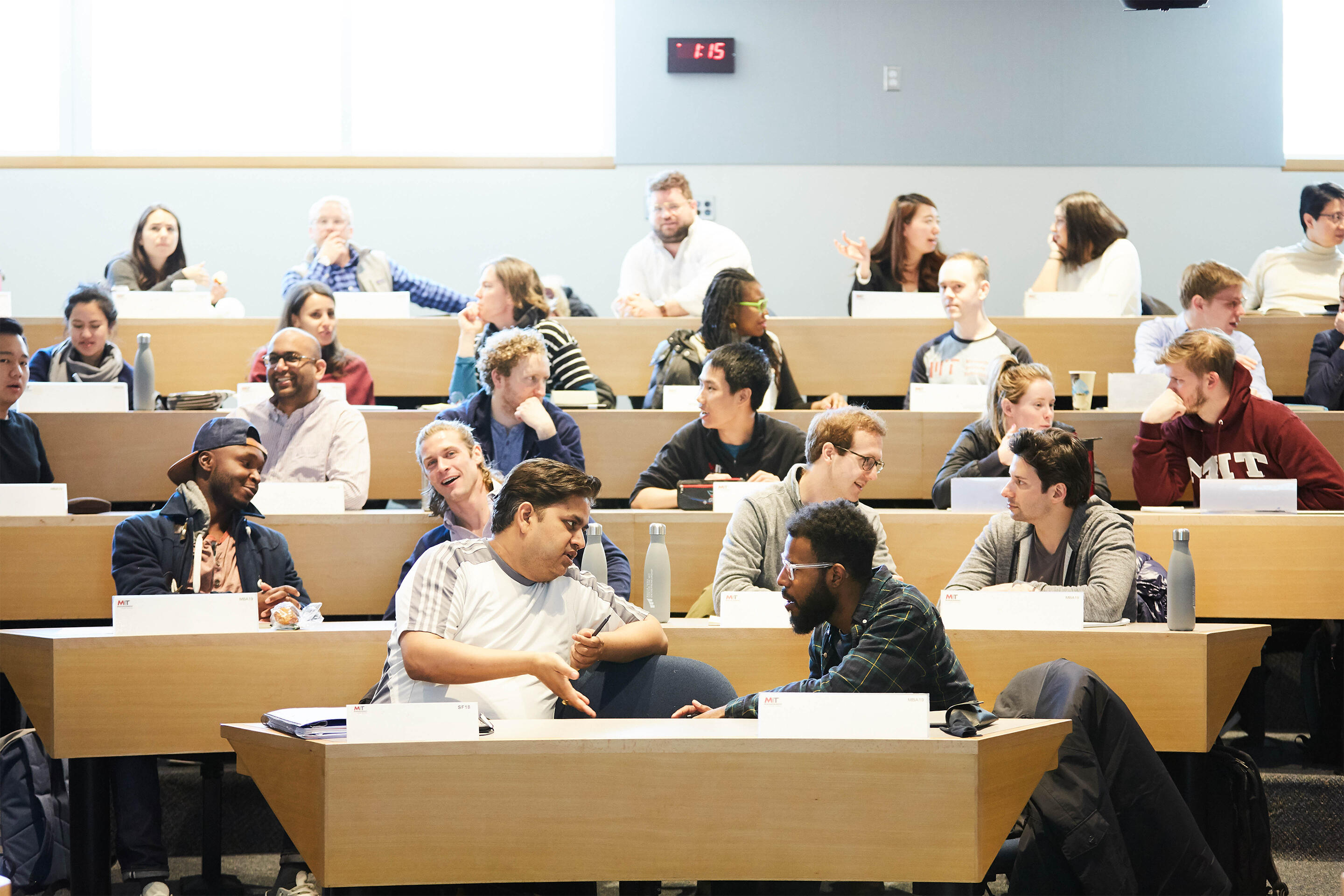MIT Sloan students in tiered classroom