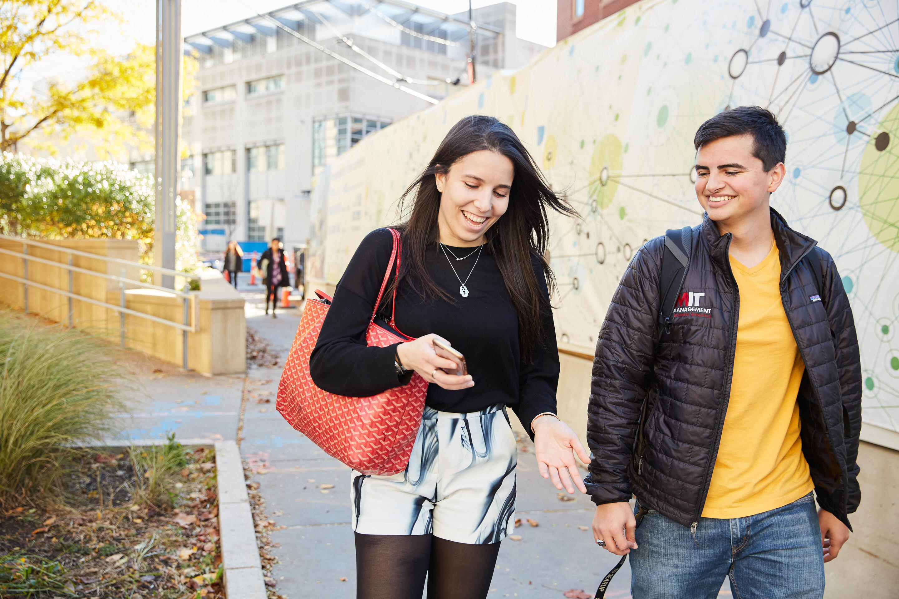 MIT Sloan students walking on campus